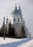 Temple of Alexander Nevsky. The village Schurala. Sverdlovsk region. Russia. Schurala, Russia - February 18, 2014: White, stone building with a dome in the Stock Images