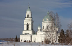 Temple of Alexander Nevsky. The village Schurala. Sverdlovsk region. Russia. Schurala, Russia - February 18, 2014: White, stone building with a dome in the Stock Photos