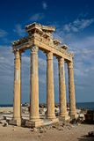 Temple of Apollo. Angled view of the ancient Temple of Apollo against a blue sky and the open sea, located in the Antalya Province, Side, Turkey Stock Image