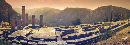 A panoramic view of Apollo`s temple in the famous archaeological site of Delphi in Greece. The temple of Apollo, God of the Light according to the ancient Greeks stock photo