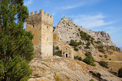 Temple of the 12 apostles and the Genoese tower. Sudak. Crimea. Old church made of natural stone. near one of the towers of the Genoese fortress. architectural Stock Photo