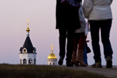Temple of assumption of the Birth-Giver of God of the Holy Virgi. Tourists examine a temple of assumption of the Birth-Giver of God of the Holy Virgin Theotokos Stock Image
