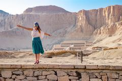 The temple on background in Luxor, Egypt. Panorama of famous ancient temple of Hatshepsut in Luxor, Egypt Stock Images