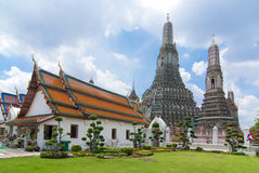Temple with background of Wat Arun. Wat Arun is among the best known of Thailand's landmarks and the first light of the morning reflects off the surface of the Royalty Free Stock Image