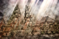 Temple in Bali. Sun streaming in from the sky on a traditional Balinese temple royalty free stock photos