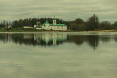 The temple on the banks of the river. Temple on the bank of the Great River in Pskov Stock Photo