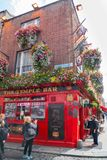 The Temple Bar with likeness of Sir William Temple on wall woman. DUBLIN, IRELAND - AUGUST 10, 2017; Tourists wander the streets of Temple Bar area a popular Royalty Free Stock Photo