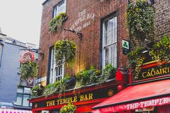 The Temple Bar pub in Dublin, arguably the most popular traditio. DUBLIN, IRELAND - April 12th, 2018: the Temple Bar pub in Dublin, arguably the most popular Royalty Free Stock Photos
