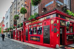 The Temple Bar. A well dressed gentleman walks the cobblestone streets in the famous Temple Bar district of Dublin, Ireland Royalty Free Stock Image