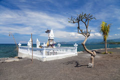 Temple and Beach at Candidasa, Bali, Indonesia. Image of a small temple and beach with volcanic black sand at Candidasa, Bali, Indonesia Stock Images