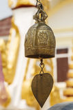 Temple Bell. With Buddhist Bodhi Leaf hanging Royalty Free Stock Images