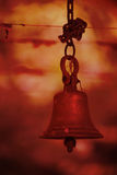 Temple Bell. An old bell in a hindu temple in saffron color light effect which represents official Hinduism color Royalty Free Stock Image