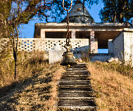 Temple bell with temple on top Stock Photos