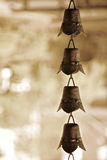 Temple bells at a Buddhist shrine. Buddhist image, temple bells on roof Royalty Free Stock Photo