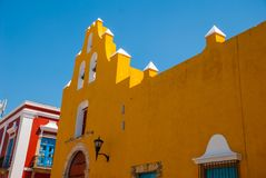 The temple with bells. Yellow church and colonial architecture in San Francisco de Campeche., Mexico.  royalty free stock photo