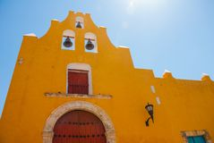 The temple with bells. Yellow church and colonial architecture in San Francisco de Campeche., Mexico. Campeche is mexican city protected by UNESCO Royalty Free Stock Photos
