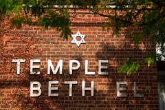 Temple Beth El. Close up of Temple Beth El sign on brick building with trees Stock Photos