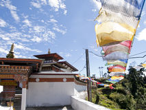 Temple in Bhutan with colorful prayerflags Royalty Free Stock Photos
