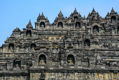 The temple of Borobudur on Java in Indonesia. Part of Borobudur Temple on Java, Indonesia. Built in the 9th century, the temple was designed in Javanese Buddhist Stock Images