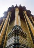 Temple buddha grand palace bangkok. Buddha between ornate pillars of temple in bangkoks royal palace thailand Royalty Free Stock Photos