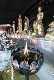 Temple of Buddha. RnTemple of Buddha. View of a burning candle in the shape of a lotus Royalty Free Stock Images