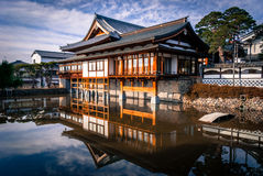 Temple building and reflection. Nagano, Japan - March 06, 2015: Daikanjin temple reflecting in Hosho pond in the early morning sunshine Royalty Free Stock Photos