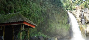 Water falls and temple in Gianyar, Bali-Indonesia stock photography