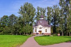 The temple chapel of All Saints, in the Russian land of lit up Stock Photo