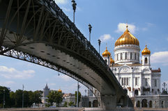 Temple of the Christ of the savior in Moscow. The foot bridge through the river to the Temple to the Christ to the Savior in Moscow (Russia Stock Photo