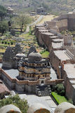 Temple and city wall at Kumbhalgarh. Kumbhalgarh Fort is a Mewar fortress on the westerly range of Aravalli Hills, in the Rajsamand District of Rajasthan state Stock Photo