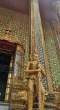 Temple with classical glass decoration srt  and golden Yaksa giant in guarding royal temple. Royal Temple and Golden Yaksa giant guarding royal temple Wat Phra Royalty Free Stock Image