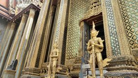 Temple with classical glass decoration srt  and golden Yaksa giant in guarding royal temple. Royal Temple and Golden Yaksa giant guarding royal temple Wat Phra Royalty Free Stock Photos