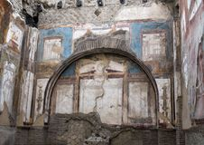 Temple in the College of Augustales in Parco Archeologico di Ercolano. Pictured is a temple in the College of Agustales in the Parco Archeologico di Ercolano Royalty Free Stock Photo