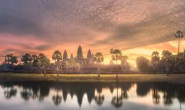 Temple complex Angkor Wat Siem Reap, Cambodia. Sunrise view of popular tourist attraction ancient temple complex Angkor Wat with reflected in lake Siem Reap Stock Image