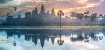 Temple complex Angkor Wat Siem Reap, Cambodia. Sunrise view of popular tourist attraction ancient temple complex Angkor Wat with reflected in lake Siem Reap and Stock Images