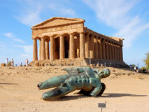 Temple of Concordia with bronze Icarus statue - Agrigento - Sicily. Doric Greek Temple of Concordia with bronze Icarus statue -   Valley of the Temple Royalty Free Stock Image