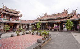Temple courtyard Taiwan. Taiwan temple in the heart of the city of Taipei. Historic colorful building with a religious history. Bonsai plants in the courtyard royalty free stock image