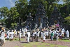 Temple Crowd, Pura Goa Lawah, Bali, Indonesia. Image of devotees entering the temple gates of Pura Goa Lawah at Bali, Indonesia Stock Photography