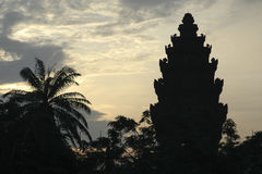 Temple at dawn. Silhouette of a temple at dawn Stock Photo
