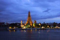 The temple of dawn in Bangkok. By the river at night Royalty Free Stock Photography