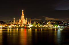 The Temple of Dawn in Bangkok, Thailand. Wat Arun, on Chao Phray. A river and a beautiful night sky in Bangkok, Thailand Stock Images