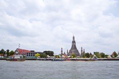 Temple of Dawn by Chaophraya river Stock Images