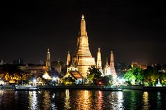 Temple of dawn during night time, scenery at the Chao Phraya Riv. Er, Bangkok, Thailand stock photography