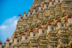 The Temple of Dawn Wat Arun and a beautiful blue sky in Bangkok, Thailand Stock Photos