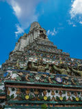 The Temple of Dawn Wat Arun and blue sky in Bangkok, Thailand.  Stock Photo