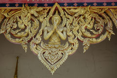 Temple decorations. Common architectural style of Buddhist temples Buddhism exhibit a different architectural and decorative approach.Buddhist monks decorate all Stock Photos