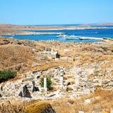 Temple  in delos greece the historycal acropolis and old ruin si. In delos greece the historycal acropolis and    old ruin site Royalty Free Stock Photos