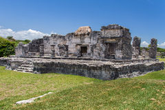 Temple of the Descending God Tulum Mexico. The facade of the ruins of the stone Temple of the Descending God with its engravings in the mayan archaeological site Royalty Free Stock Photo