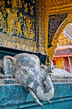 Temple Detail, Laos. A Buddhist temple detail of a silver tiled elephant in Laos Stock Image