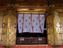 Temple door curtain. Open golden door to a Japanese Buddhist temple with white curtain Stock Image